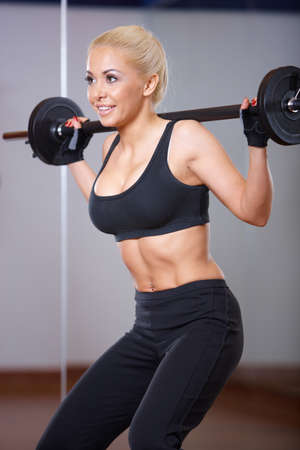 Beautiful woman exercising at the gym Stock Photo
