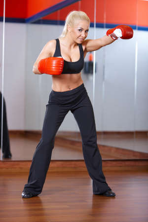 Beautiful woman exercising at the gym photo