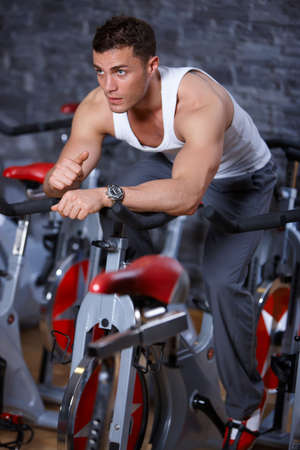 cardio fitness: Handsome man at the gym doing exercises