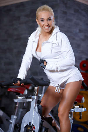 Beautiful woman exercising at the gym Stock Photo - 7316002