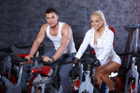 Sporty couple exercising at the gym photo