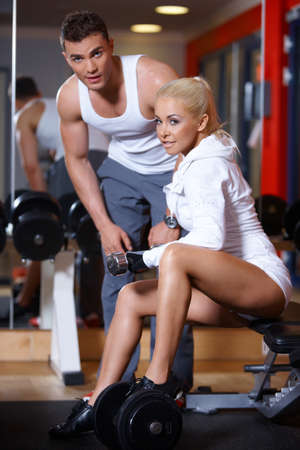 Sporty couple exercising at the gym Stock Photo - 7316029