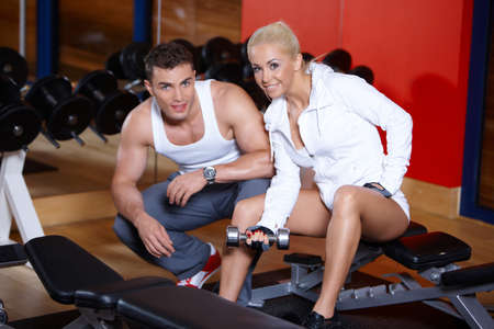 Sporty couple exercising at the gym Stock Photo - 7315999