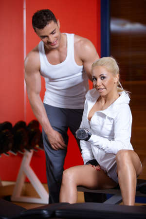Sporty couple exercising at the gym Stock Photo - 7315975