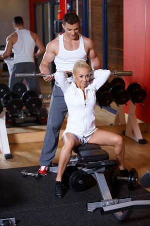 Sporty couple exercising at the gym Stock Photo - 7316055