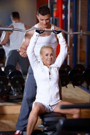 Sporty couple exercising at the gym Stock Photo - 7316022