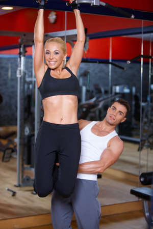 Sporty couple exercising at the gym Stock Photo - 7315992