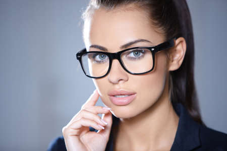 wearing glasses: Portrait of beautiful business woman wearing glasses