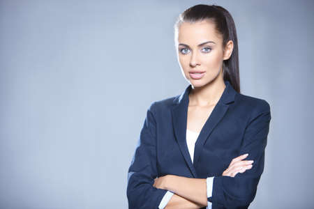 Portrait of beautiful business woman on gray background Stock Photo - 7366148