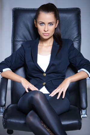 Portrait of beautiful business woman sitting on chair photo