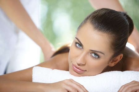 Beautiful woman is resting on spa bed photo