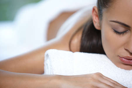 body treatment: Beautiful woman is resting on spa bed