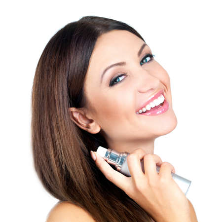Portrait of beautiful woman she is holding bottle of perfume photo