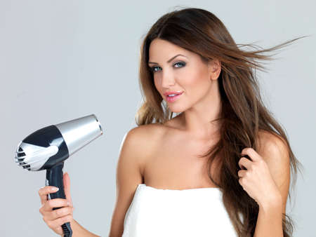 Portrait of beautiful woman, she holding hair dryer Stock Photo - 7790656