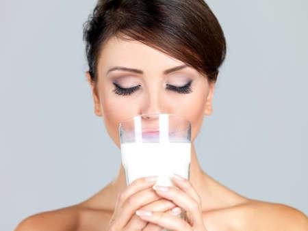Portrait of beautiful woman, she holdin glass of milk photo