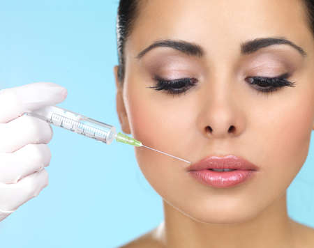 Beautiful woman gets botox injection in her face Stock Photo - 7790749