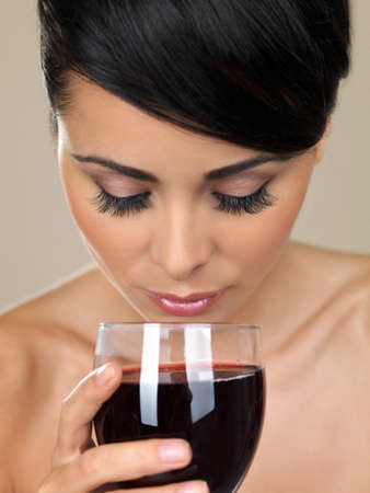 Portrait of beautiful woman, she holding glass of red wine photo