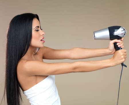 Portrait of beautiful woman, she holding hair dryer Stock Photo - 7790826
