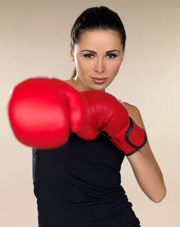 girl punch: Young beautiful woman during fitness and boxing