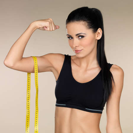 measure waist: Young beautiful woman after fitness time and exercising