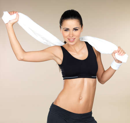 woman in towel: Young beautiful woman after fitness time and exercising