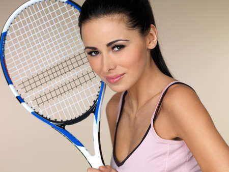 Beautiful female tennis player on natural background photo