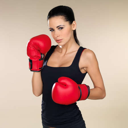female boxer: Young beautiful woman during fitness and boxing