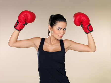 Young beautiful woman during fitness and boxing photo