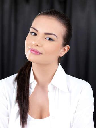 Portrait of beautiful woman on black backgound photo
