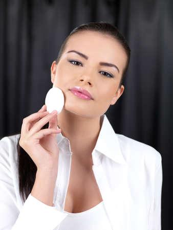 Portrait of beautiful woman, she doing makeup photo