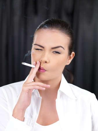 Portrait of beautiful woman, she smoking cigarette Stock Photo - 7961125
