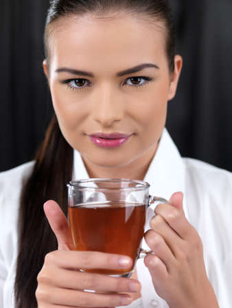 Portrait of beautiful woman she holding cup of tea photo