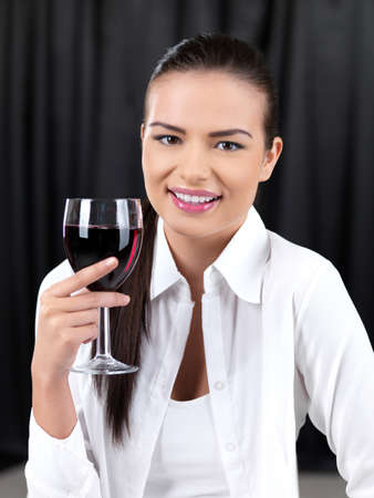 Portrait of beautiful woman with glass of red wine photo