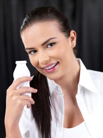 Portrait of beautiful woman, she holding bottle of milk photo