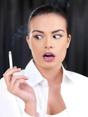 Portrait of beautiful woman, she smoking cigarette photo