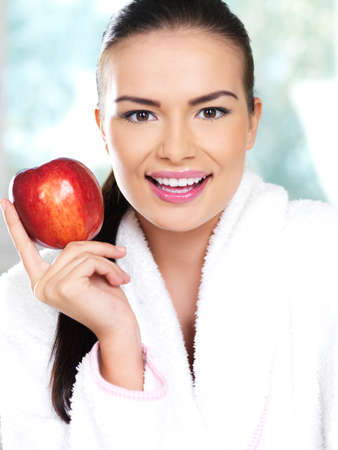 Portrait of beautiful woman, she holding red apple photo