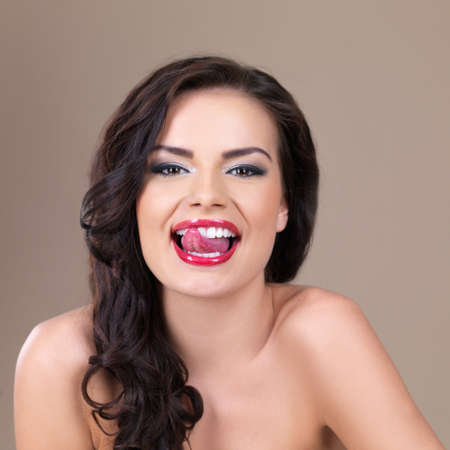 Portrait of happy beautiful woman with red lipstick photo