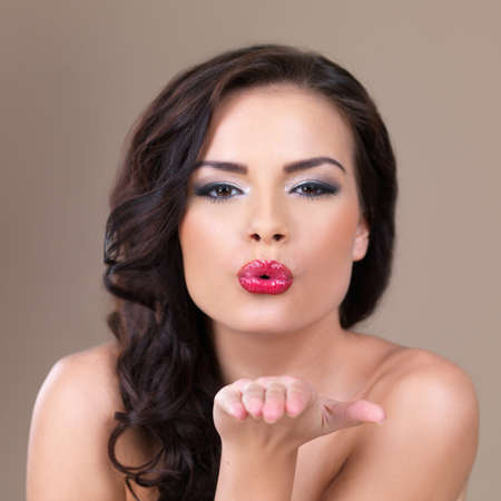 Portrait of sexy beautiful woman sending kiss photo
