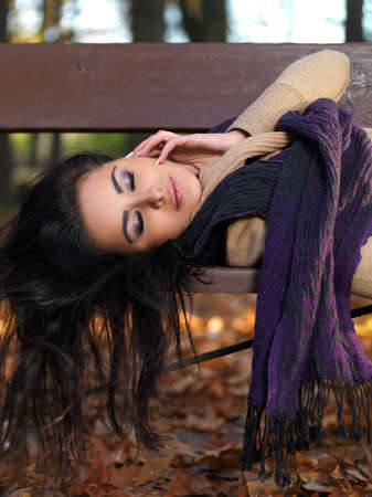 Beautiful woman spending time in park during autumn season photo