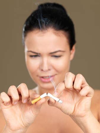 Portrait of beautiful woman, she braking a cigarette photo