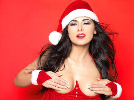 girl sexy nude: Mujer bella y sexy vestir traje de cl�usula de santa Foto de archivo