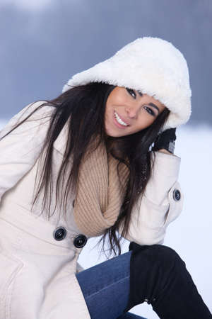 Beautiful and sexy woman in snowy winter outdoors photo