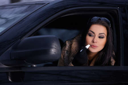 Beautiful woman in car in snowy winter outdoors Stock Photo - 8383712