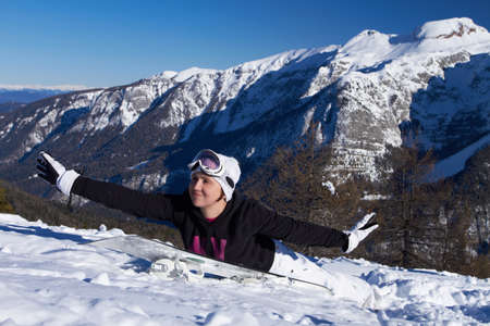 Young snowboarder is having fun on snowboard photo