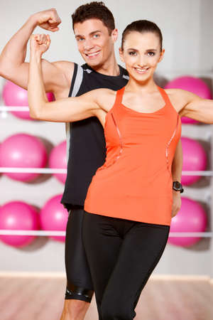 Sporty couple exercising at the fitness gym Stock Photo - 9796033