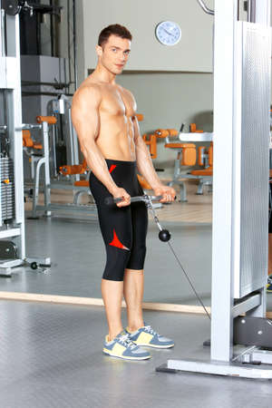 Handsome man at the gym doing exercises Stock Photo - 9796062