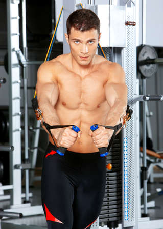 Handsome man at the gym doing exercises Stock Photo - 9796028