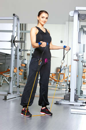 Beautiful woman exercising at the fitness gym Stock Photo - 9795797