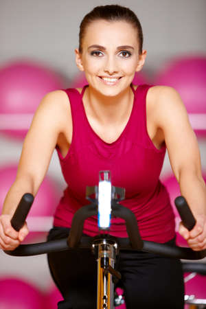 Beautiful woman exercising at the fitness gym Stock Photo - 9795997