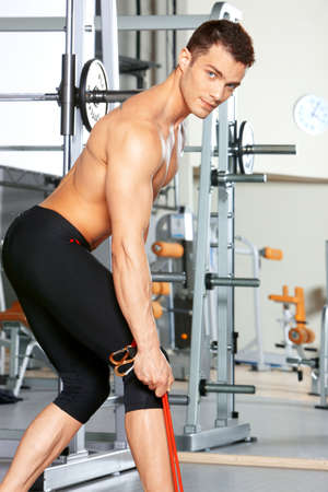 Handsome man at the gym doing exercises Stock Photo - 9796036